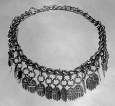 Kuffat fatmeh amuletic choker or head ornament | Ta'amreh Bedouin tribe, Bethlehem region | Early 20th century | Silver | The eye depicted in the middle of each hamsa is believed to bestow protection against evil powers.