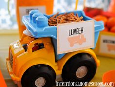 2 year old boy birthday ideas on the cheap. Really? This was dreamed up by someone who does not have kids. Because any 2 year old seeing this will dump the dump truck and roll it over the pretzels to crunch them. Bad idea.o