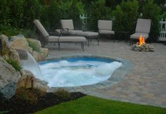 inground hot tubs and spas design pictures | Another attractive element is the natural gas camp fire which brings ...