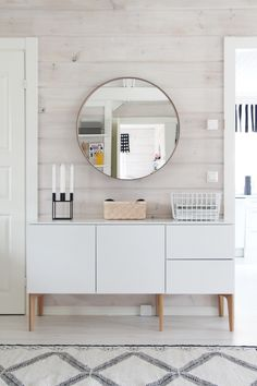 whitewashed shiplap | rug | mirror