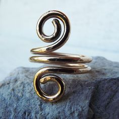 'Hand forged brass swirl ring any size' is going up for auction at 11pm Thu, Sep 20 with a starting bid of $5.