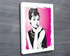 Audrey Hepburn Pink Canvas Print from $26.00. This artwork depicts Audrey Hepburn in a pop art canvas print with a pink and white background that is ready to be delivered. As with all art on this site, we offer these prints as stretched canvas prints, framed print, rolled or paper print or wall stickers / decals. http://www.canvasprintsaustralia.net.au/  #birthdaypresentideas #popart  #retirementgifts