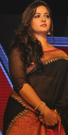 #Anushka Shetty (Sweety) posing cute in Black #Saree during Audio Release of her upcoming film #Rudramadevi.