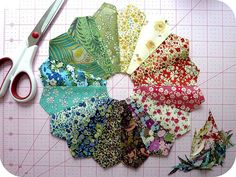 This is actually just a picture of a Dresden quilt pattern piece to be used. I am pinning it because the color/pattern selection is interesting ~ via French Knot