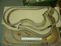 Some folks have asked to see the track layout plan, I've not got the darwing anymore but I do have some early photos of the start of construction. Here you see all the track is laid; showing the th...