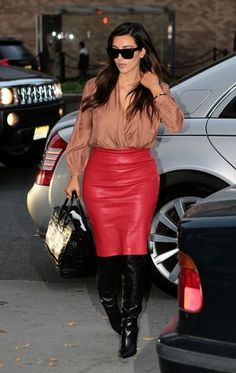 Kim Kardashian-Not the colors but the leather skirt and blouse cute combo with knee boots.