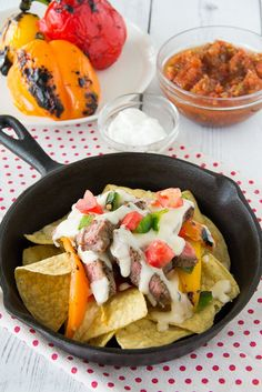 Grilled steak, sweet peppers & spicy jalapeno piled on tortilla chips & then drenched in a cheesy ale based Mornay sauce make this nacho treat complete.