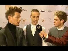 One Direction being interviewd on the Red Carpet - Bambi Awards 22.11.12. hahaha Lou in a turtle neck lollolll