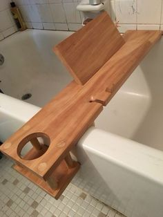 Bathtub Buddy for my wife. It holds a book or tablet so you can read or watch shows in the tub. It also has a cup holder and a recessed slot for a wineglass. Maple with marine-grade polyurethane sealer. - Diy for Home Decor Bathtub Tray, Bathtub Caddy, Bath Tub, Bath Trays, Diy Wood Projects, Home Projects, Wood Crafts, Woodworking Plans, Woodworking Projects