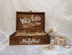 Wishes For The New Mr. & Mrs. Wood Heart Guest Book, Unique Wedding Guest Book, Guest Book Alternative, Rustic Guest Book, Guest Book. This guest book box is 9.5 x 6.25 x 3.5 inches in size. It is stained brown and shows the imperfections of the wood. Wishes for the new Mr. and Mrs. is done in white vinyl. Inside the box, there is 50 wood hearts and a Sharpie Pen decorated with jute ribbon and an ivory flower. The wood hearts are separated into 5 piles of 10 and tied with jute ribbon…