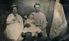 Based on evidence from a new batch of photos recently acquired from a distant cousin, this is my 3rd-great grandparents, HENRY HEIMSOATH amd his wife, GENEVA OVERMAN, along with their first two children, William and Jennie. Photo taken about 1876/1877.