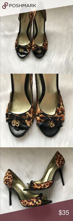 Guess Leopard Print Sandal Open Toe sandal with bow, G and heart gold charm details. Worn only a few times and is in great condition. Size 6.5 Guess Shoes Heels