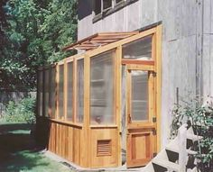 A lean-to greenhouse is probably the way to go. These attached greenhouses are typically around 4′x8′ and can be made of reclaimed windows