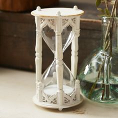 Features:  -Material: Metal.  -Color: White.  -Free standing.  Product Type: -Hourglass.  Style (Old): -Traditional.  Subject: -Home decor and furniture.  Finish: -White.  Handmade: -Yes.  Primary Mat