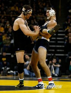 Iowa's Nathan Burak wrestles Penn State's Quentin Wright during their 197 pound match in their dual meet Friday, Feb. 1, 2013 at Carver-Hawkeye Arena in Iowa City.  (Brian Ray/The Gazette-KCRG)