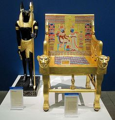 king tut's chair - This is a picture of king tuts chair made of solid Gold . This Gold crafted chair represents evolutionary versions of furniture which had been used for royal purposes since Egypt's Early Dynastic Period . I absolutely like how this chair looks, the detailing, carving, colors are just too beautiful and the fact that this chair was made centuries ago shows talented human beings are. picture from Google Search