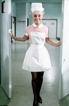Barbara Windsor as naughty Nurse Sandra May in 'Carry On, Doctor' 1967 Nylons, Ross Kemp, Sidney James, Blouse Nylon, Queen Vic, Barbara Windsor, British Comedy, Nursing Clothes, Boris Johnson