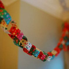 Use old/left-over wrapping paper to create paper chains for holiday decorating.