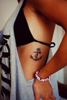 Sexy female anchor tattoo
