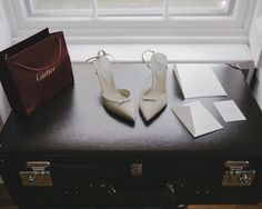 """Karen Kaiser, stylist - """"My personal style revolves around pieces that are timeless, which you can see in my wedding essentials: Cartier wedding bands, Altuzarra leather pointed-toe pumps, engraved wedding invitations custom-designed by Maureen Meyer, and a Globe-Trotter trunk."""""""