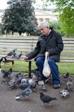 """""""I love coming to the park and feeding the birds"""" — in London, United Kingdom. #london #birds #park #memories #people #life #world #memoriesoftheworld #food #alzheimer #hope"""
