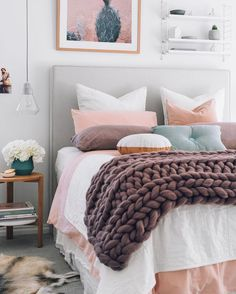 Nice layered look here in this bedroom with muted pinks and blue-greys. That chunky knitted throw is adorable too!