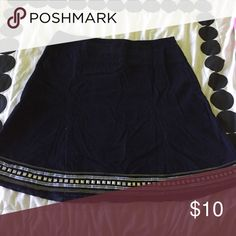 Skirt that is perfect for fall! A very thin corduroy material. It is very light weight with a boho embellished trim. American Eagle Outfitters Skirts A-Line or Full