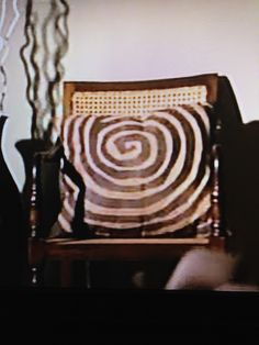 Spiral / coil pillow from Mitch and Cam's house on Modern Family tv show. If anyone knows where to get this pillow, please let me know!!