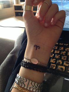 small Aries sign tattoo