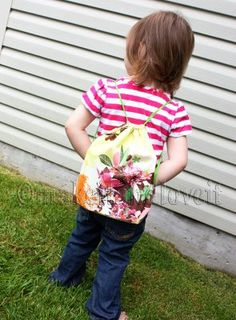 Margo met a little girl with a cinch backpack like this and wants one.  Of course I'm looking at it thinking, I could make that.  I think this is our next sewing project together!