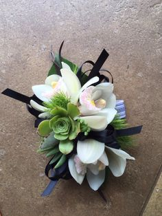 Orchid corsage with succulents and texture. $39.99