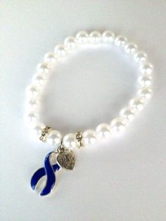 Charmed by Stacy Colon Cancer Awareness Bracelet , http://www.amazon.com/dp/B0091UMZO4/ref=cm_sw_r_pi_dp_NDsoqb0FNH41A