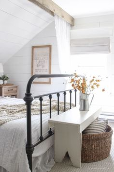 Modern Farmhouse- Shiplap walls, exposed wood beam, and wood bench with jute basket and natural colors