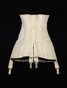 Corset- during the 20's corset became shorter, had straps hanging from them, and aimed to flatted the breasts. Designer: A.J. Lecoutre. Manufacturer: Royal Worcester COrset Co. American and made of cotton, metal, bone, and elastic.