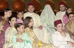 A photo of HM King Mohammed VI of Morocco with his heavily veiled bride, Salma Bennani, on their wedding day, March 21, 2002. The bride dressed traditionally including the heavy veil, but after the wedding showed her beautiful red hair wearing a diamond meander tiara.