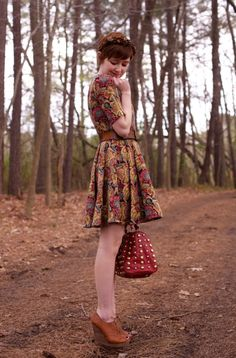 The epitome of vintage romantic. Love the flower crown in her hair. #vintage #romantic #fallfashion