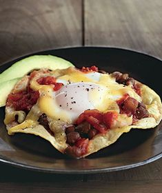 Huevos Rancheros, by Real Simple. The eggs are baked on top of the salsa and beans, making this extra easy.