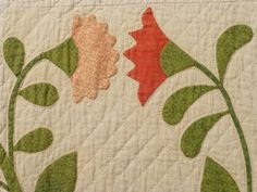 Coxcomb and Rose Applique with Pieced Sunbursts and Vine border. Third quarter of the 19th-Century. Traditional applique quilts from the 19th-Century