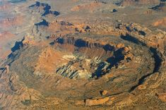 Upheaval Dome - an impact crater later eroded by flood waters and breached on one side to drain