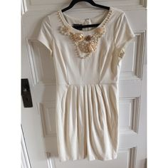 Muse Cream Embellished neck dress - size 12 Muse Cream embellished neck dress - size 12  gorgeous dress with satin and tulle flowers, gold chain, and pearls along your neck line. Pleated waist. Like new worn a couple times. Comes from smoke free and pet free home! Muse Dresses