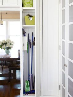 Most of us think to stash cleaning supplies under the sink, but consider using a vertical cabinet to store stick brooms and related cleaning supplies. It will move your gear from the coat closet and put them where you need them most: the kitchen.
