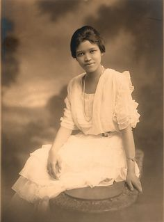 Sadie T.M. Alexander (1898-1989), B.S. 1918, A.M. 1919, Ph.D. 1921, LL.B. 1927, in pearls and white graduation dress, portrait photograph. First African American woman to earn a Ph.D.