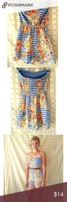 Strapless Floral Romper This adorable summer romper is made of very light cotton. It has a soft sweetheart shape for the bust, a few gold buttons adorning the front and two small pockets along each side at the waist! It has an elastic back to ensure a comfortable fit. kandy kiss Dresses Strapless