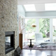 This modern space features a fireplace clad in Najavo Architectural Travertine from #thetileshop #travertine #fireplace