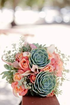 Try autumn colors at your beach wedding for a complementary palette. Echeveria, or dessert plants, mix well with traditional flowers like roses.