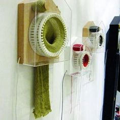 Knitting clock makes one stitch every half-hour; one scarf per year. Designed by Siren Elise Wilhelmsen and exhibited at the Milan Furniture Fair.  Freaking cool!