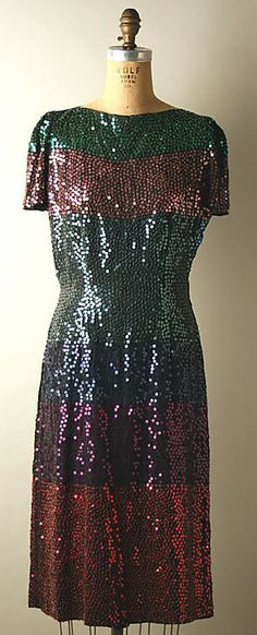 "Multi-colored sequined dress, by Normal Norell, American, early 1940s. Part of the ""Subway Costume"" with black wool coat with velvet collar."