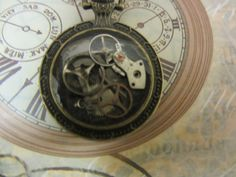 Steampunk Watchcase pendant, Genuine watch parts Embedded in clear resin Antique bronze chain Ideal gift Unisex by InspiredbySteamPunk on Etsy