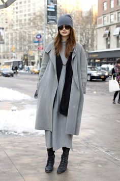 Anastasia Shatokhina, model : wearing a Narciso Rodriguez coat and a H clack jacket. The dress and hat are both by Margiela for H (image: vogue)