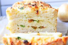 Recipe for spicy bread with onions and cheese Ingredients: 1limpa bread◾7 -8 cups flour◾1 package dry yeast (12 g)◾4 tbls butter, melted◾3 cups lukewarm milk◾2 eggs◾1/2 tsp. salt◾1/2 tsp. sugar Filling to bread◾20g melted butter ◾French dried spices (yes used my bruschetta mix)◾3 tablespoons parsley, roughly chopped◾3 cloves garlic, pressed ◾1 garlic, toasted in a pan◾1/2 cup Parmesan cheese, grated◾1/2 cup cheddar cheese, grated Design: